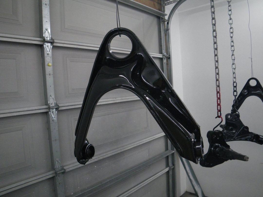 Upper Control Arms in Epoxy.JPG